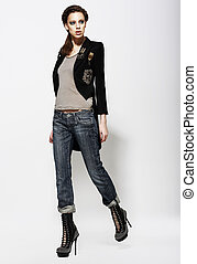 Fashionable Glamorous Woman in Jeans and High Boots. Vogue Style