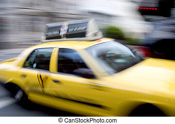 """Shot of passing taxi is blurred to give the sense of """"hurry it up!"""" motion. Shot of passing taxi is blurred to give the sense of """"hurry it up!"""" motion."""