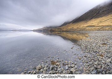 fjord in iceland, stormy wather, wide angle