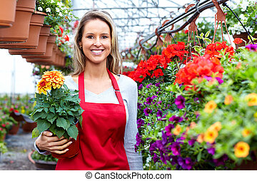 Florists woman working at flower a shop.