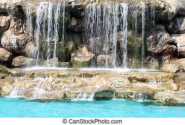 flowing waterfall in swimming pool