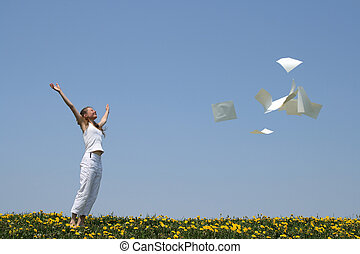 Laughing girl throws in air blank paper sheets (with copy space), freeing herself from paperwork.