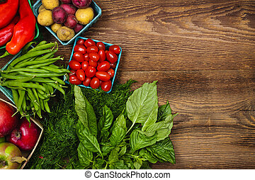 Fresh farmers market fruit and vegetable from above with copy space on brown wood