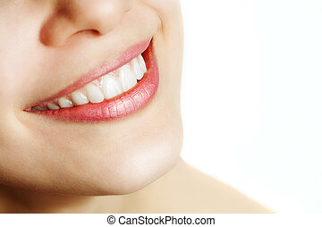 Fresh smile of woman with healthy teeth over white
