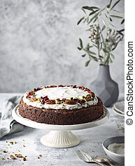 Freshly baked delicious carrot cake with nuts and dried fruits