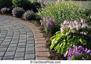 Interlocking stone walk with flower bed