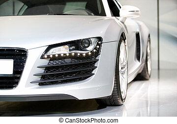 german luxury sport car close up shot