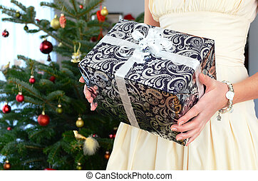 Girl with a Christmas gift in the hands