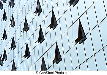 Glass building wall with open windows