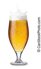 glass of beer with splashing foam