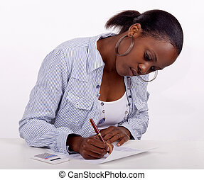 Gorgeous young South AFrican woman filling in a form.