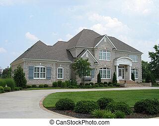 gray brick house in upscale neighborhood