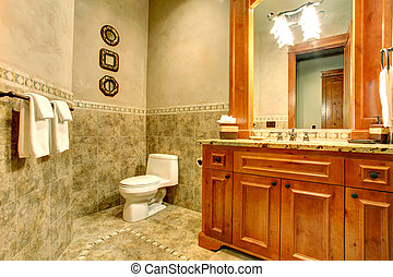 Green and gold bathroom interior