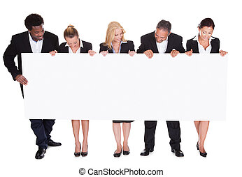 Group Of Happy Business People With Placard Over White Background