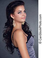 Hair. Beauty Woman With Long Black Hair. Hairstyle. Beautiful Model Girl Portrait. Earrings. Accessory