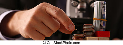 Hand businessman in suit hold quarter