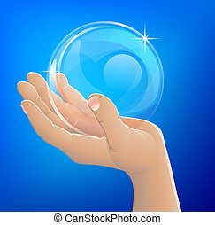 Hand holding bubble or glass ball