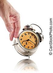 Hand knocking down vintage clock
