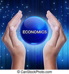 Hand showing blue crystal ball with economics word. business concept