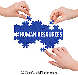 Hands with puzzle making HUMAN RESOURCES word isolated on white