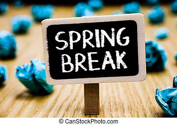 Handwriting text Spring Break. Concept meaning Vacation period at school and universities during spring Blackboard crumpled papers several tries mistake not satisfied wooden floor.