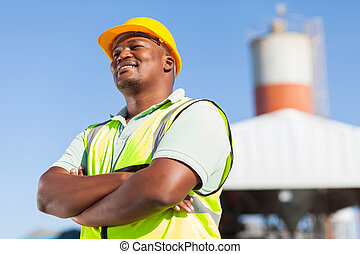 happy african male constructor with arms folded