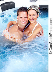 Happy couple in a hot tub.