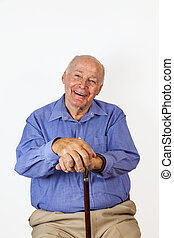 happy elderly man sitting in a chair
