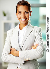 Portrait of successful businesswoman looking at camera with smile