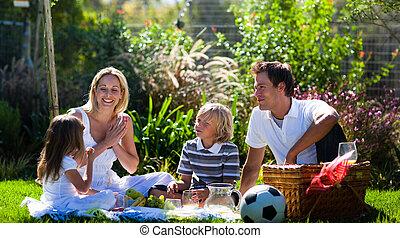 Happy family enjoying the sun in a picnic