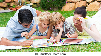 Happy family painting in a park