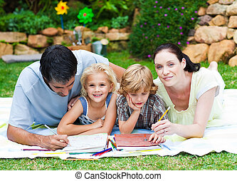 Happy family writing in a park