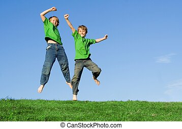 happy healthy kids, jumping in summer