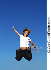 happy kid or child jumping