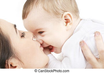 happy mother kissing baby boy