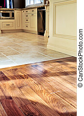 Hardwood and tile floor in residential home kitchen and dining room