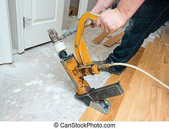 A hardwood floor installation in progress.