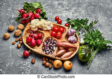 Harvest vegetables with herb kitchen garden