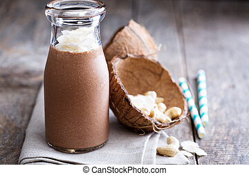 Healthy vegan chocolate coconut cashew shake in a bottle
