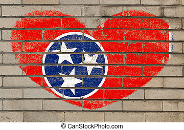heart shape flag of tennessee on brick wall