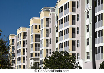High contrast multi colored high rise condominiums with individual balconys