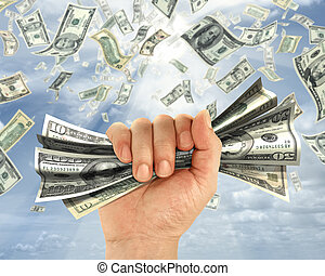 Wealth idea in a metaphor of the hand holds some dollars.