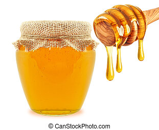 honey in jar and dipper isolated on white background