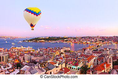 Hot air balloon over Istanbul sunset