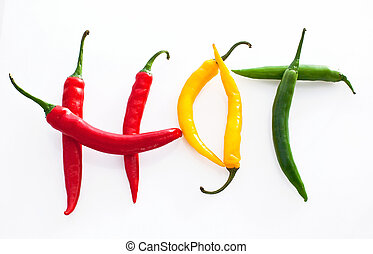 Hot word made from red, yellow and green hot chili pepper on white background