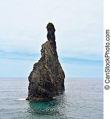 Madeira island. Ilheus da Rib and Ilheus Janela rocks in Atlantic ocean.