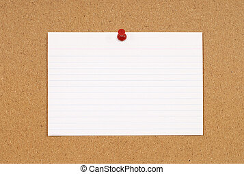 Cork notice or bulletin board with blank white office index card. Space for copy.