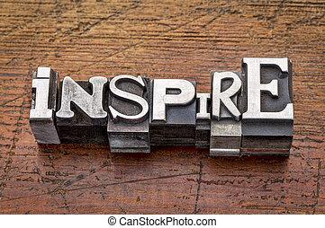 inspire word in mixed vintage metal type printing blocks over grunge wood
