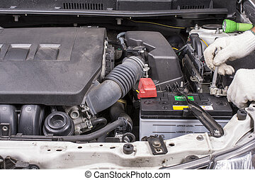 Install the new car battery for automobile maintenance