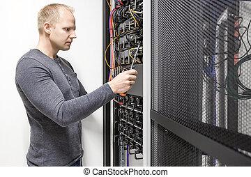 Installs communication rack in datacenter